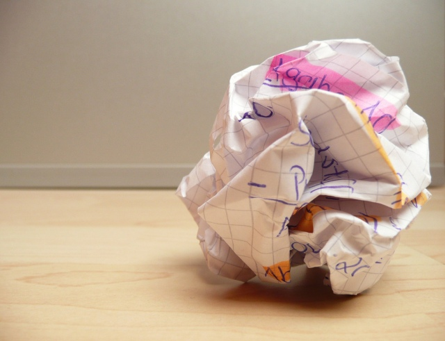 Overcoming writers block - crumpled paper on wooden floor - Photosteve101